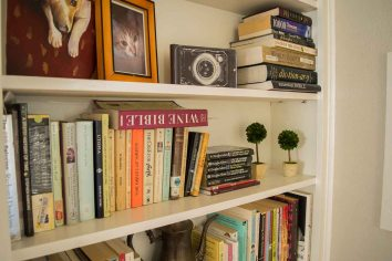 Books, photos, and mementos on the built-in bookshelf.