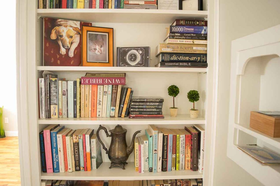 Books, photos, and mementos on a built-in bookshelf.