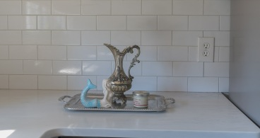 Silver tray and heirloom real silver teapot.