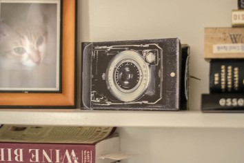 A photo album with a vintage camera on the cover.