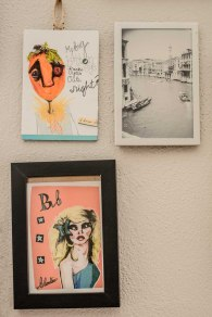 Two small prints and a photograph hang on the wall of Stephanie's office.