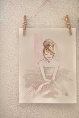 A watercolor portrait of Stephanie hangs on the wall in her office.