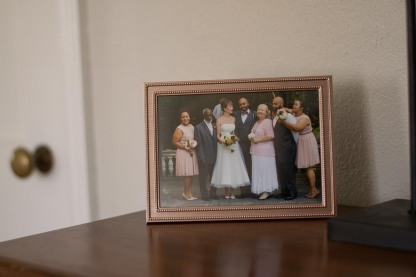 A framed photo of Jason and Stephanie and some family members as they pose for after wedding photos.