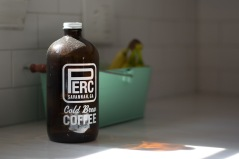 Coffee growler sits on kitchen counter.