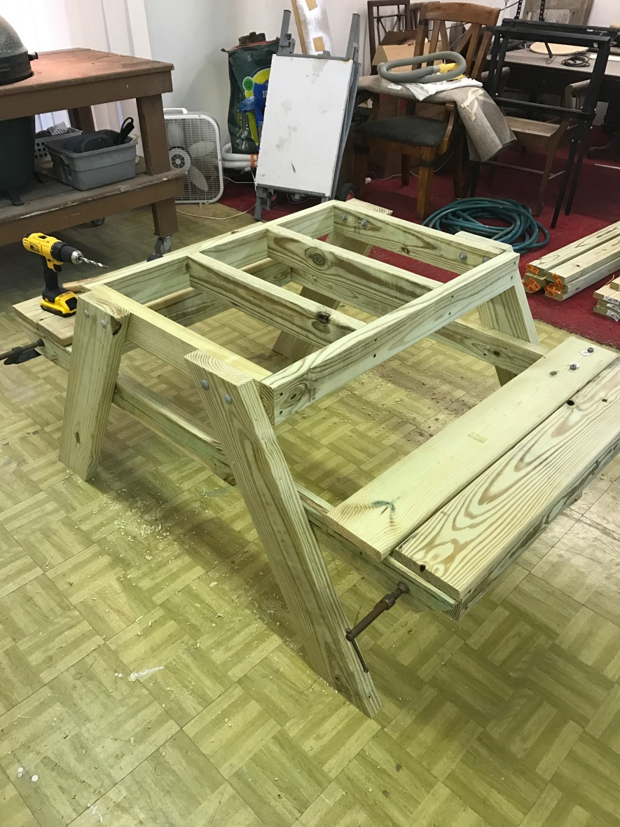 The picnic table in progress in Thomas's workshop.