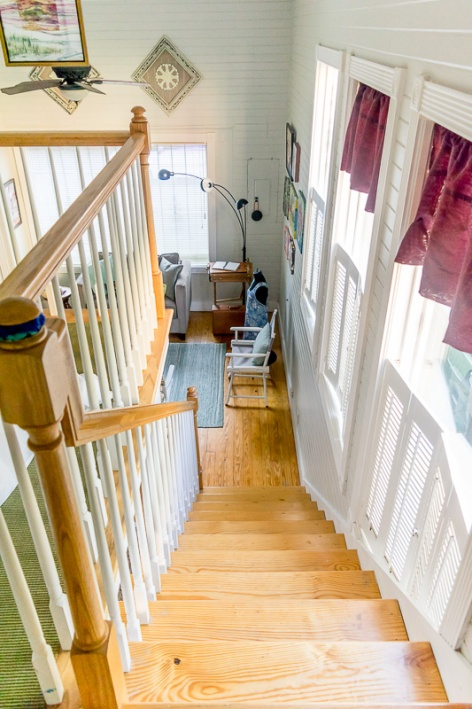 Stairs leading down from the lofted area.
