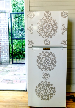 Fridge with a graphic and bedazzled print.