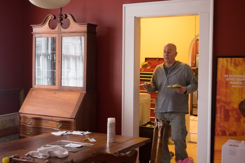 Thomas walks into the dining room from the kitchen to serve breakfast.