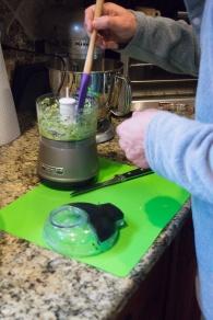 Thomas mixes the cucumber.